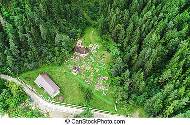 old wooden church in the forest. Romania, Poiana Largului