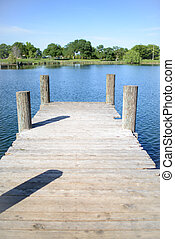 Old Wooden Deck with Lake in Background