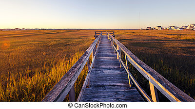 old wooden dock at sunset