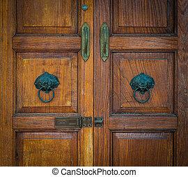 Old wooden door and ancient door knocker