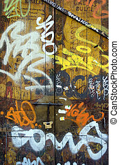 Old wooden door covered in graffiti