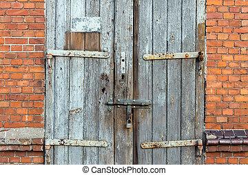 Old wooden door. Grunge background texture for design