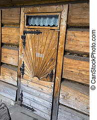 old wooden door in a village hut