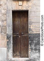 Old wooden door in brick wall