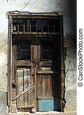 Old wooden door in ruin