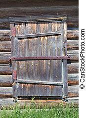 old wooden door in timbered wall - old wooden door in an old...