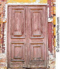 old wooden door in wall