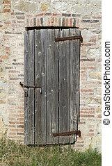 old wooden door - old rundown wooden door on stone facade