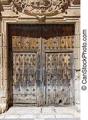 Old wooden door on a facade