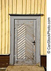 old wooden door on wall