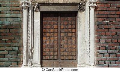 old wooden door opening to green screen.
