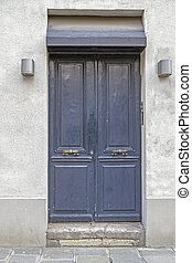 Old wooden door, seen in Paris, France