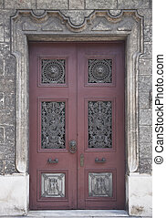 Old wooden door with decorations in historical house