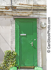 Old wooden door with electrical cables, seen in Paris, France