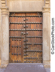 old wooden door with iron ornaments