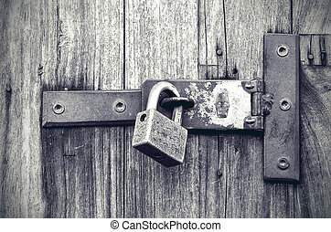 Old wooden door with key lock