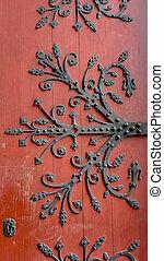 old wooden door with metal ornaments
