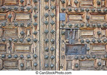 old wooden door with nails