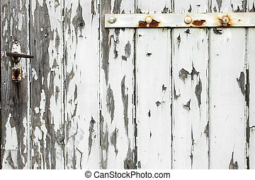 Old wooden door with peeling paint