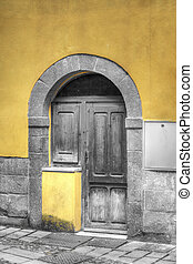 old wooden door with selective desaturation - old wooden...