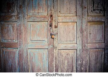 old wooden doors ancient with padlock on door