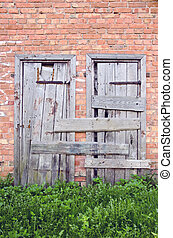 old wooden doors on wall