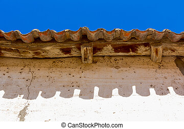 Old wooden eaves in white house