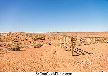 Old wooden fence in the sandy desert