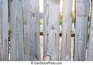 old wooden fence in the village near house