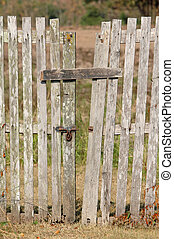 old wooden fence with a gate
