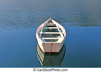 Old wooden fisher boat in lake