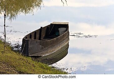Old wooden fishing boat at lake Kerkini in Greece