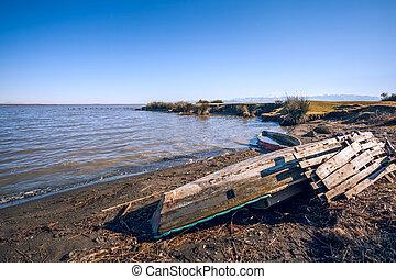 old wooden fishing boat in the lake Paliastomi, Poti, Georgia