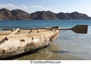 Old wooden fishing boat on the beach of Taganga