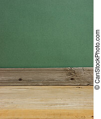 old wooden floor with green wall