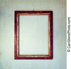 old wooden frame on a gray grunge background. toned image