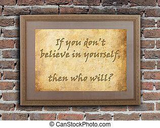 Old wooden frame with written text on an old wall - Believe in yourself