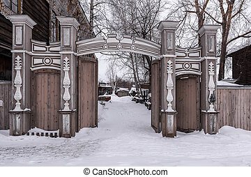 Old wooden gate of a residential building