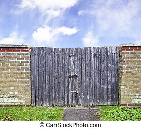 old  wooden gate with metal lock