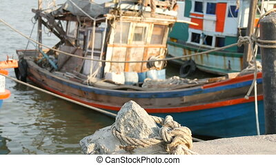 Old wooden half-ruined ship moored on a fishing dock - An...