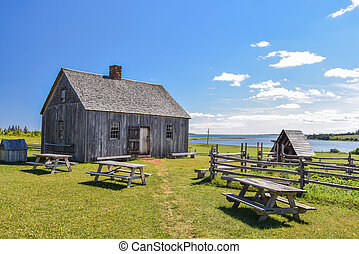 Old wooden house and benches by the ocean
