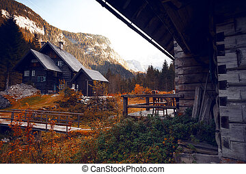 old wooden house in the mountains. beautiful mountains landscape.