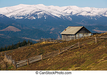 wooden house in winter mountain background