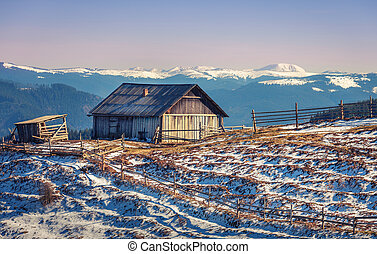 wooden house in winter mountain