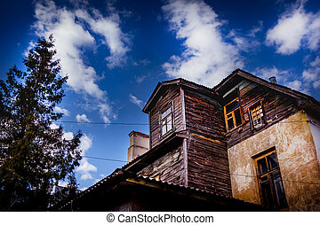 old wooden house on sky background
