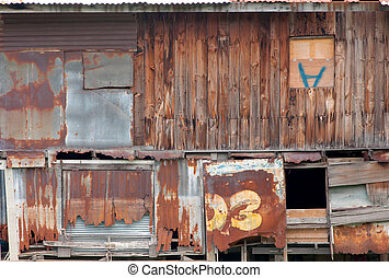 Old wooden house wall and decay zinc window