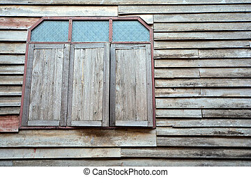 Old wooden house wall with wooden window. texture background