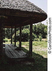 Old wooden house with a thatched roof