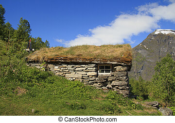 Old wooden house with grass roof in Norway