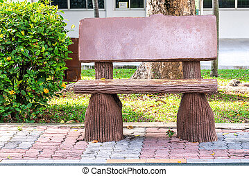 Old wooden log bench in a outdoor park